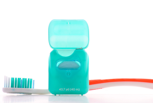 Toothbrush with dental floss