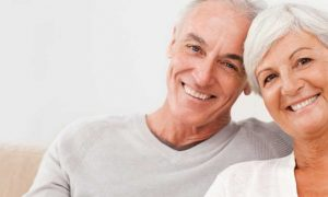 Mature man and woman smiling