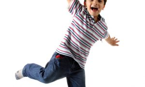 Child with big smile jumping in the air
