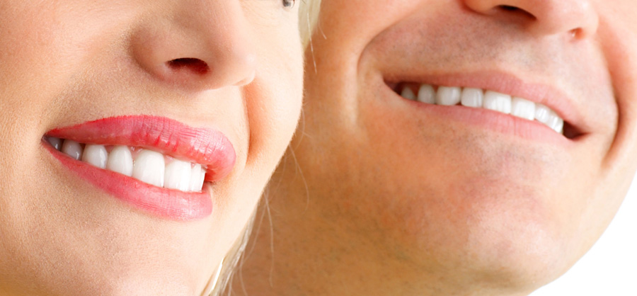 up close view of a couple smiling with white teeth