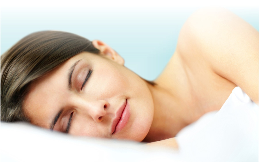 woman sleeping comfortably on white pillow