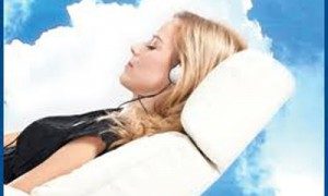 Woman in dental chair relaxing with a bed of clouds in the background